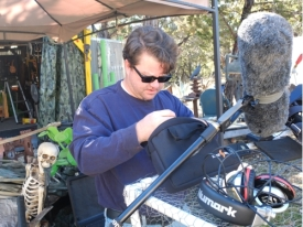 Mr. Bones watches Jason Marion ready the sound recording gear