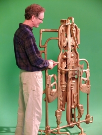 Rob Mahoney with Marvin Niebuhr's big sculpture
