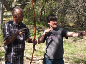 John & Rodger consider good form in archery.