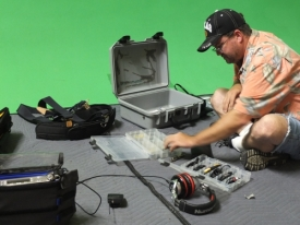 No, he's not going fishin'. Jason Marion selects the right cable or connector for recording the audio.