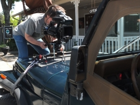 Rodger Marion attaches the camera to Paul's Jeep for a trip thru town.