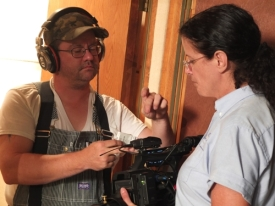 Jason Marion adjusts the audio receiver, while  Andrea Ballentine holds the camera.