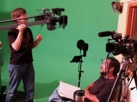 Rodger Marion adjusts the camera for Scene 39 with Jason Foreman
