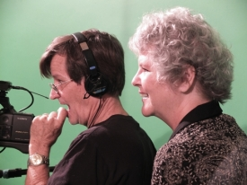 Rodger and Carla watch the playback